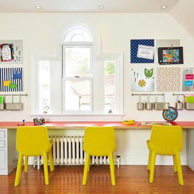 Transitional gender-neutral medium tone wood floor kids' room photo in Wilmington with beige walls