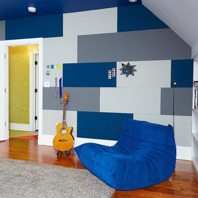 Kids' room - large modern boy medium tone wood floor and brown floor kids' room idea in Wilmington with gray walls