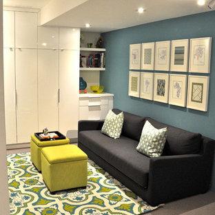 Ejemplo de dormitorio infantil de 1 a 3 años, moderno, pequeño, con paredes azules y moqueta