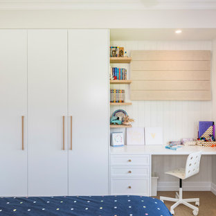 This is an example of a transitional kids' bedroom for kids 4-10 years old and girls in Brisbane with white walls and beige floor.