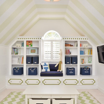 Example of a transitional gender-neutral carpeted kids' room design in Orlando with white walls