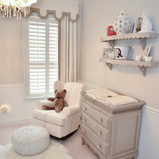 Example of a mid-sized transitional gender-neutral carpeted kids' room design in Orlando with beige walls