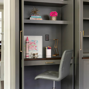 Example of a transitional girl brown floor and dark wood floor kids' study room design in Minneapolis with gray walls