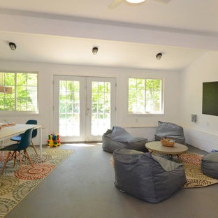 Large midcentury kids' room in New York with white walls, concrete floors and grey floor.