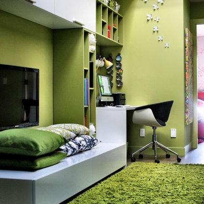 Example of a trendy gender-neutral dark wood floor kids' room design in Vancouver with green walls