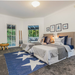 Design ideas for a mid-sized beach style kids' room for boys in Brisbane with white walls, carpet and grey floor.