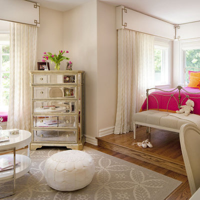 Kids' room - mid-sized eclectic girl medium tone wood floor kids' room idea in Los Angeles with pink walls