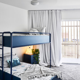 This is an example of a small contemporary kids' room in Sunshine Coast with white walls, carpet and grey floor.