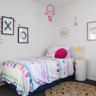 Beach style kids' room in Other with white walls, carpet and grey floor for kids 4-10 years old and girls.