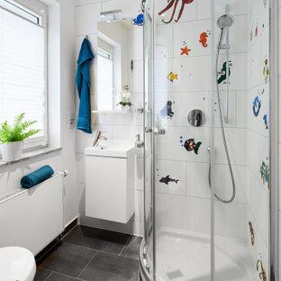 Immagine di una grande cameretta per bambini contemporanea con pareti bianche e pavimento in ardesia