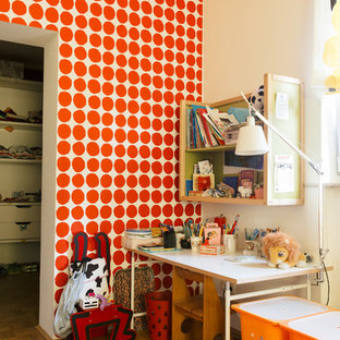 Mid-sized eclectic gender-neutral medium tone wood floor kids' study room photo in Berlin with multicolored walls