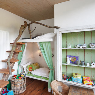 Example of a cottage chic girl medium tone wood floor childrens' room design in Cologne with white walls