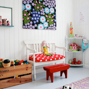 Example of a cottage chic girl painted wood floor and gray floor kids' room design in Munich with white walls
