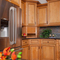 "Honey Rope 36 Bathroom Vanity 1 - The Honey Rope kitchen cabinet collection offers a cool, casual, and warm kitchen. These cabinets have exquisite roping detail and the light wood tones appeal to all home owners. If you're looking for a well-crafted cabinet that is timeless and elegant than look no more! These cabinets come with soft close, dovetail drawer features and concealed 6-way adjustable hinges. The beauty and quality can't be beat! Width 36"" Height 34.5"" Depth 21"".  Bathroom vanity that has 2 doors on the right, 1 fake drawer front on top, and 2 drawer on the left."