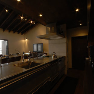 Mid-sized asian open concept kitchen ideas - Mid-sized zen single-wall dark wood floor and brown floor open concept kitchen photo in Osaka with stainless steel cabinets, stainless steel countertops and an island