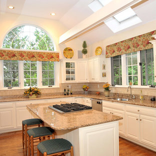 Traditional kitchen ideas - Inspiration for a timeless kitchen remodel in Philadelphia with raised-panel cabinets, white cabinets, beige backsplash and paneled appliances