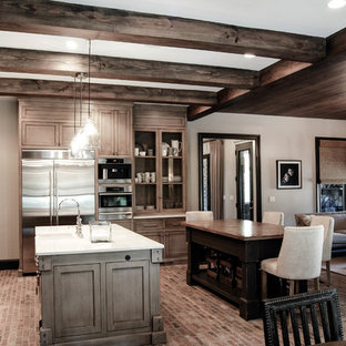 Inspiration for a country eat-in kitchen in Other with an undermount sink, glass-front cabinets, distressed cabinets, brick floors and multiple islands.