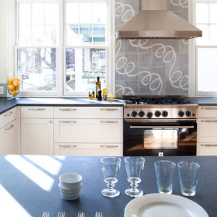 Inspiration for a timeless kitchen remodel in DC Metro with shaker cabinets, white cabinets, gray backsplash and black appliances