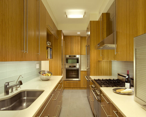 Mid Sized Contemporary Galley Enclosed Kitchen Idea In New York With Glass Tile Backsplash
