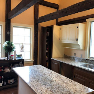 Open concept kitchen - small rustic galley medium tone wood floor and brown floor open concept kitchen idea in Other with a single-bowl sink, dark wood cabinets, granite countertops, stainless steel appliances, an island and multicolored countertops