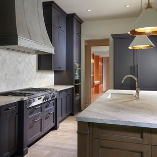 This is an example of a mid-sized u-shaped kitchen in Miami with a drop-in sink, louvered cabinets, purple cabinets, marble benchtops, grey splashback, marble splashback, stainless steel appliances, light hardwood floors, with island and multi-coloured floor.
