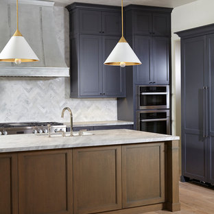 Inspiration for a mid-sized u-shaped kitchen in Miami with a drop-in sink, louvered cabinets, purple cabinets, marble benchtops, grey splashback, marble splashback, stainless steel appliances, light hardwood floors, with island and multi-coloured floor.
