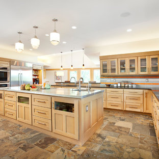 This is an example of a large contemporary u-shaped open plan kitchen in Other with shaker cabinets, light wood cabinets, multi-coloured splashback, stainless steel appliances, an island, a submerged sink, granite worktops, metro tiled splashback, travertine flooring, multi-coloured floors and grey worktops.