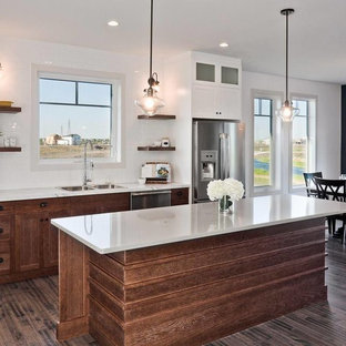 Eat-in kitchen - transitional eat-in kitchen idea in Other with a drop-in sink, dark wood cabinets, white backsplash, subway tile backsplash and stainless steel appliances