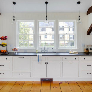 Traditional kitchen designs - Elegant l-shaped medium tone wood floor kitchen photo in Boston with a single-bowl sink, shaker cabinets, white cabinets and no island