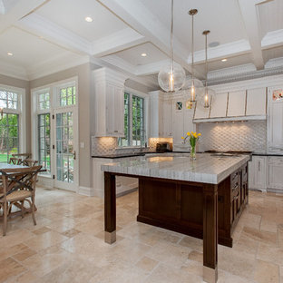 Large contemporary eat-in kitchen ideas - Example of a large trendy u-shaped limestone floor and beige floor eat-in kitchen design in Chicago with shaker cabinets, white cabinets, solid surface countertops, white backsplash, ceramic backsplash and an island