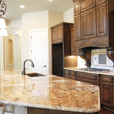 Rustic Kitchen by Glazier Homes