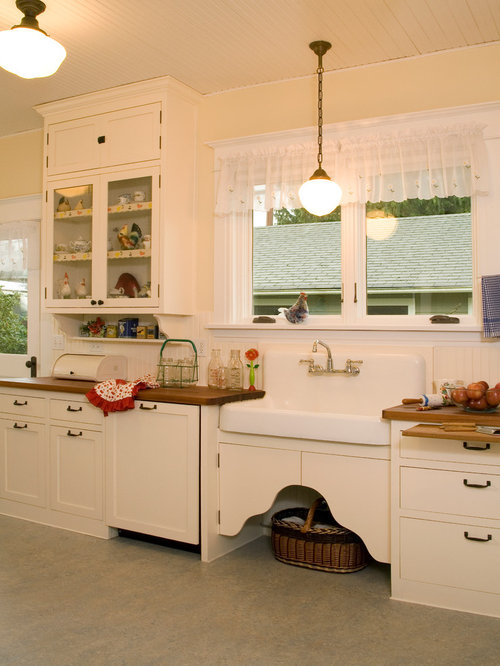 historic kitchen design. Shabby chic style kitchen idea in Seattle with a farmhouse sink and wood  countertops Historic Kitchen Houzz