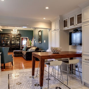 Mid-sized contemporary open concept kitchen inspiration - Example of a mid-sized trendy l-shaped marble floor open concept kitchen design in Nashville with raised-panel cabinets, white cabinets, white backsplash, ceramic backsplash and an island