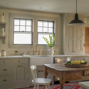 Kitchen - cottage kitchen idea in New York with a farmhouse sink, gray cabinets, marble countertops, gray backsplash, stainless steel appliances and an island