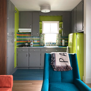 Photo of a midcentury l-shaped kitchen pantry in New York with a drop-in sink, flat-panel cabinets, grey cabinets, laminate benchtops, ceramic splashback, coloured appliances, linoleum floors, turquoise floor and turquoise benchtop.