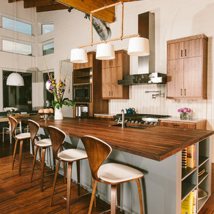 Modern kitchen remodeling - Example of a minimalist kitchen design in Austin with wood countertops