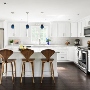 Mid-sized transitional eat-in kitchen appliance - Inspiration for a mid-sized transitional l-shaped vinyl floor and brown floor eat-in kitchen remodel in Boston with white cabinets, quartzite countertops, white backsplash, subway tile backsplash, stainless steel appliances, an island and white countertops