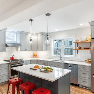 Large transitional kitchen designs - Large transitional l-shaped medium tone wood floor and brown floor kitchen photo in Detroit with a double-bowl sink, gray cabinets, white backsplash, porcelain backsplash, stainless steel appliances, an island, shaker cabinets and white countertops