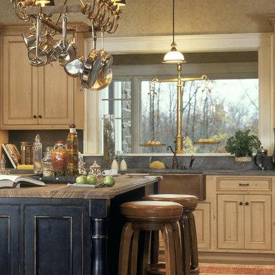 Elegant kitchen photo in New York with a farmhouse sink, beaded inset cabinets, distressed cabinets, soapstone countertops, gray backsplash and stone slab backsplash