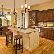 Traditional Kitchen by Plum and Crimson Fine Interior Design