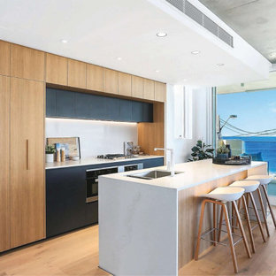This is an example of a beach style kitchen in Sydney.