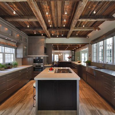 Large mountain style u-shaped travertine floor enclosed kitchen photo in New York with stainless steel appliances, flat-panel cabinets, an integrated sink, medium tone wood cabinets, concrete countertops, gray backsplash, ceramic backsplash and an island