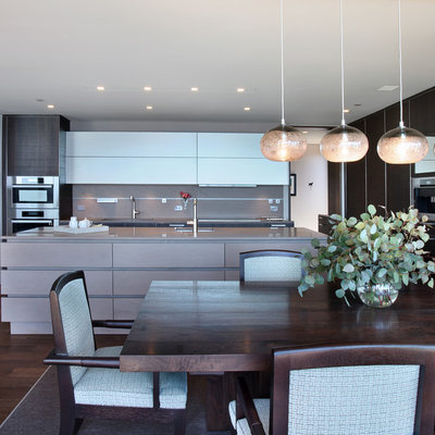 Example of a trendy l-shaped eat-in kitchen design in Orange County with flat-panel cabinets, dark wood cabinets and concrete countertops