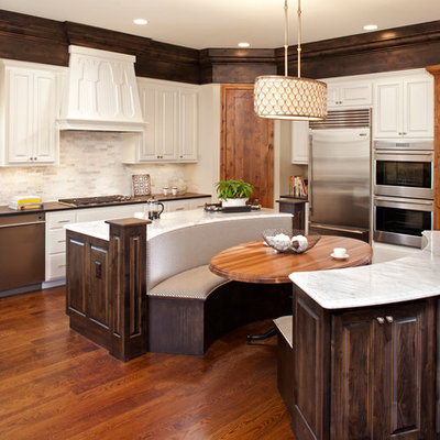 Elegant eat-in kitchen photo in Minneapolis with raised-panel cabinets and white cabinets