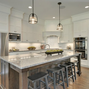 Traditional kitchen photos - Kitchen - traditional kitchen idea in Minneapolis with an undermount sink, recessed-panel cabinets, white cabinets, white backsplash, subway tile backsplash and stainless steel appliances