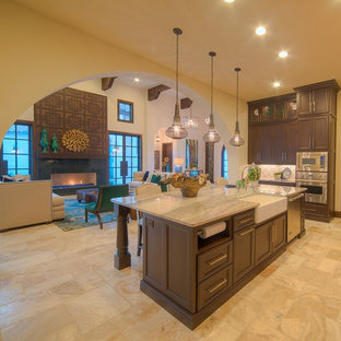 Open concept kitchen - large mediterranean u-shaped ceramic floor and beige floor open concept kitchen idea in Austin with an undermount sink, recessed-panel cabinets, dark wood cabinets, granite countertops, multicolored backsplash, mosaic tile backsplash and stainless steel appliances