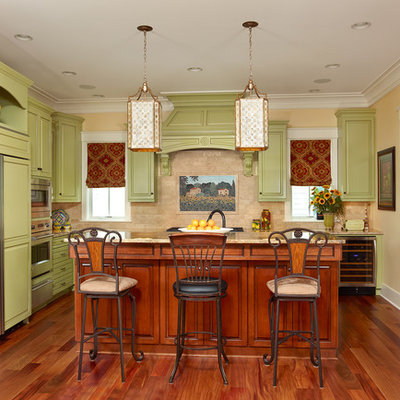Inspiration for a timeless kitchen remodel in Charleston with granite countertops, green cabinets, raised-panel cabinets, paneled appliances, an island and beige backsplash