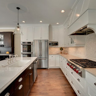 Example of a classic kitchen design in Minneapolis with stainless steel appliances and stone tile backsplash