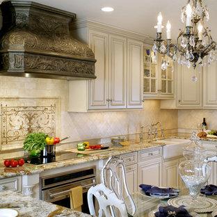 Imagen de cocina comedor en L, tradicional, pequeña, con fregadero sobremueble, armarios con paneles con relieve, encimera de granito, electrodomésticos de acero inoxidable y suelo de piedra caliza