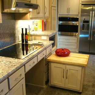 This is an example of a small traditional galley kitchen pantry in Minneapolis with a submerged sink, shaker cabinets, light wood cabinets, granite worktops, metallic splashback, stone tiled splashback, stainless steel appliances, lino flooring and no island.